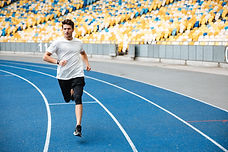 storyblocks-athlete-man-running-on-a-rac