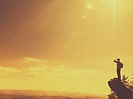 graphicstock-man-at-the-edge-of-a-cliff-