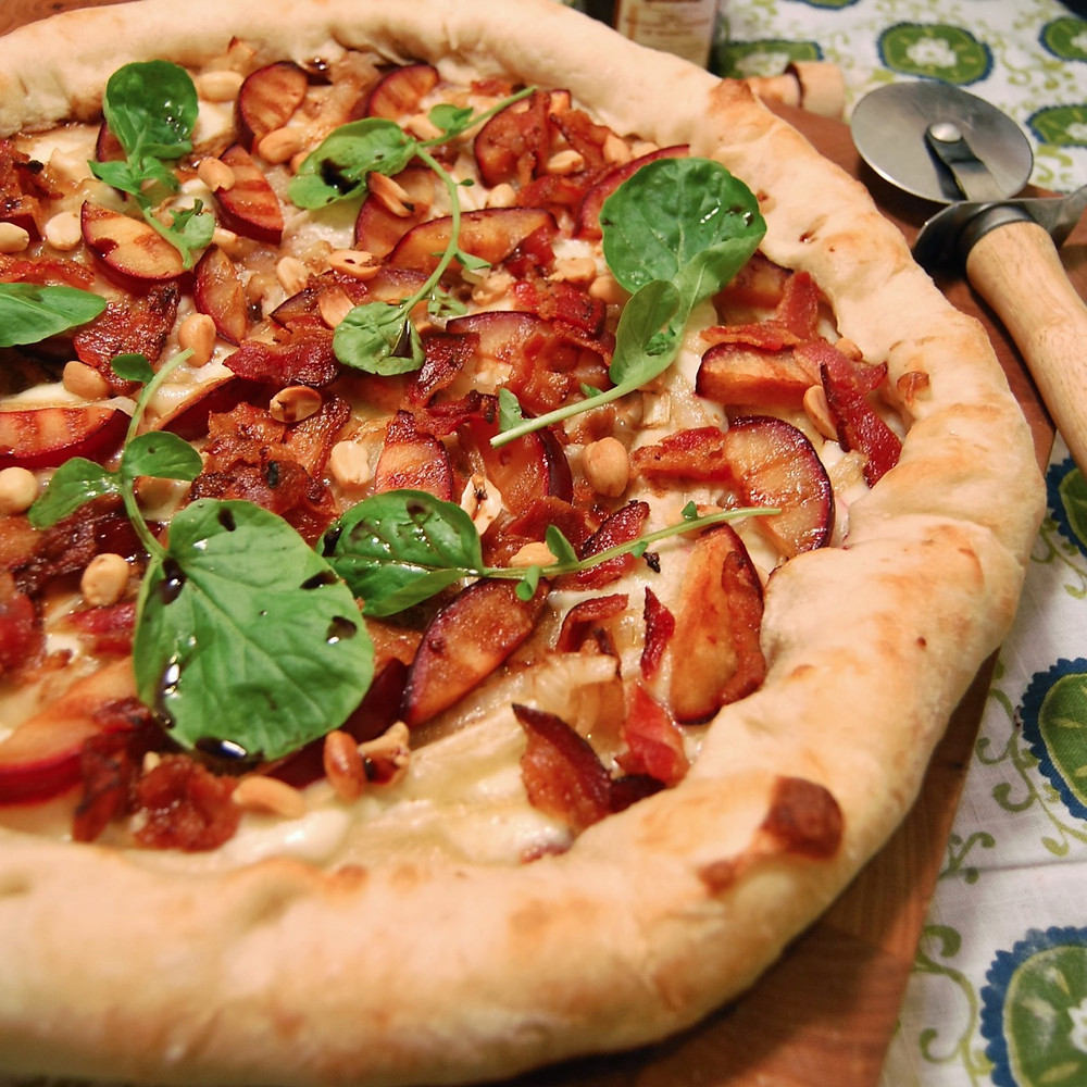 Plums, peanuts & bacon pizza