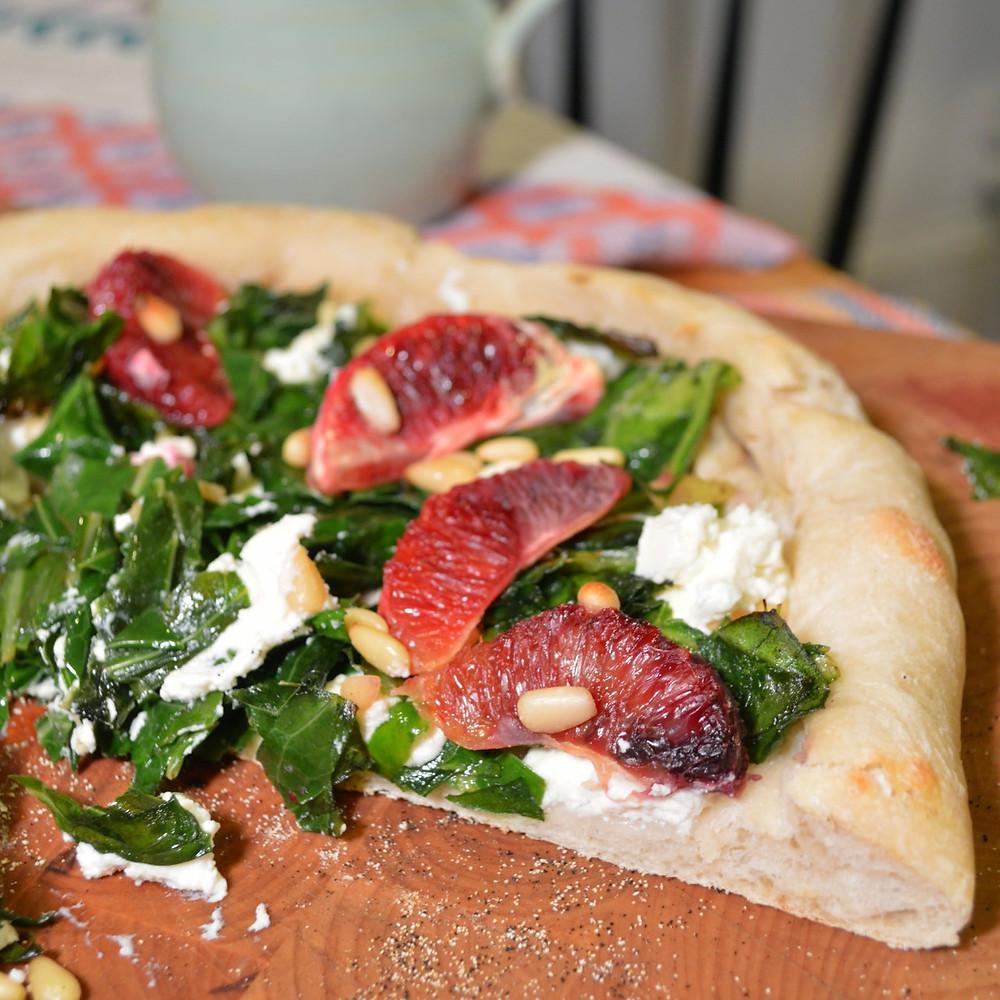 Blood orange & spiced collard green pizza