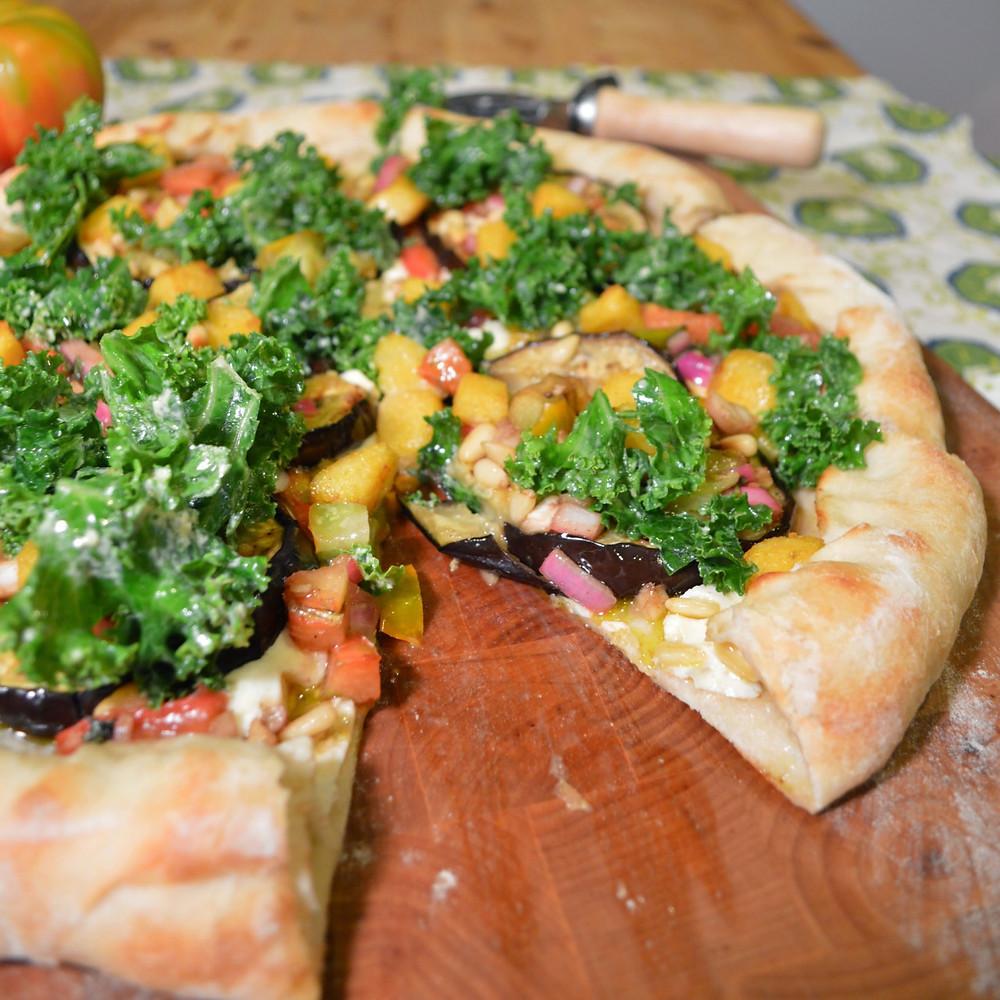 Kale Caesar, eggplant & bruschetta pizza