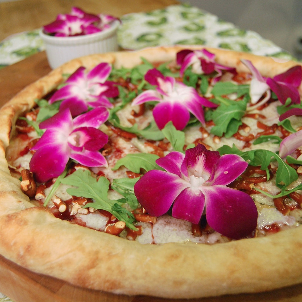 Poached plum & orchid pizza
