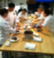 busy chefs at work in a large kitchen