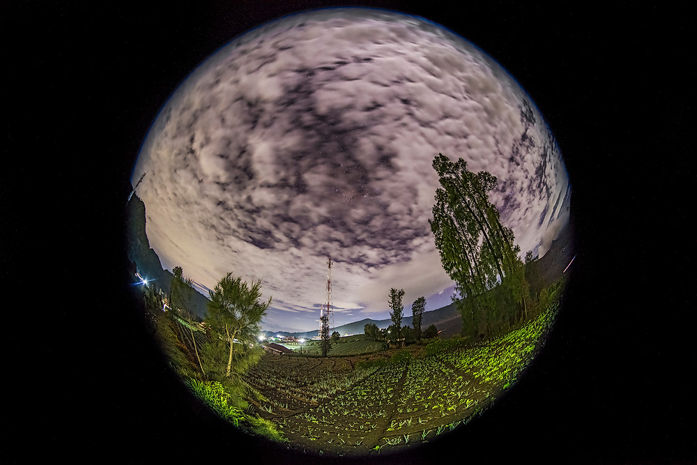 a sphere fill with textured clouds, with the small farms at Cemoro Lawang