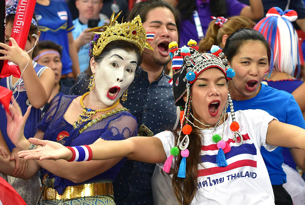 Passionate Thailand Soccer fans posing