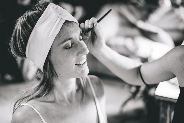 Bride having her makeup done.