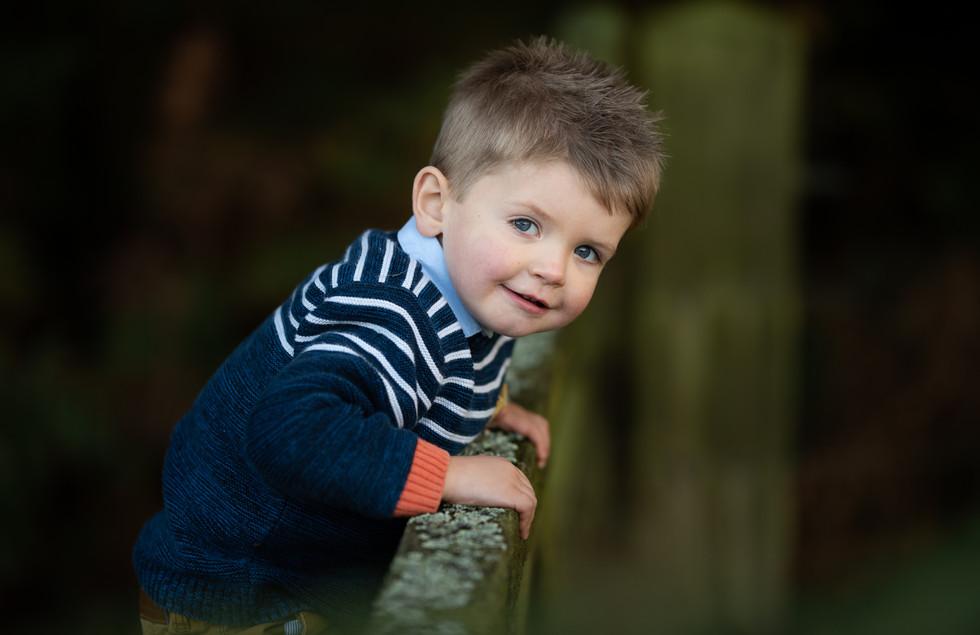 boy on fence.jpg