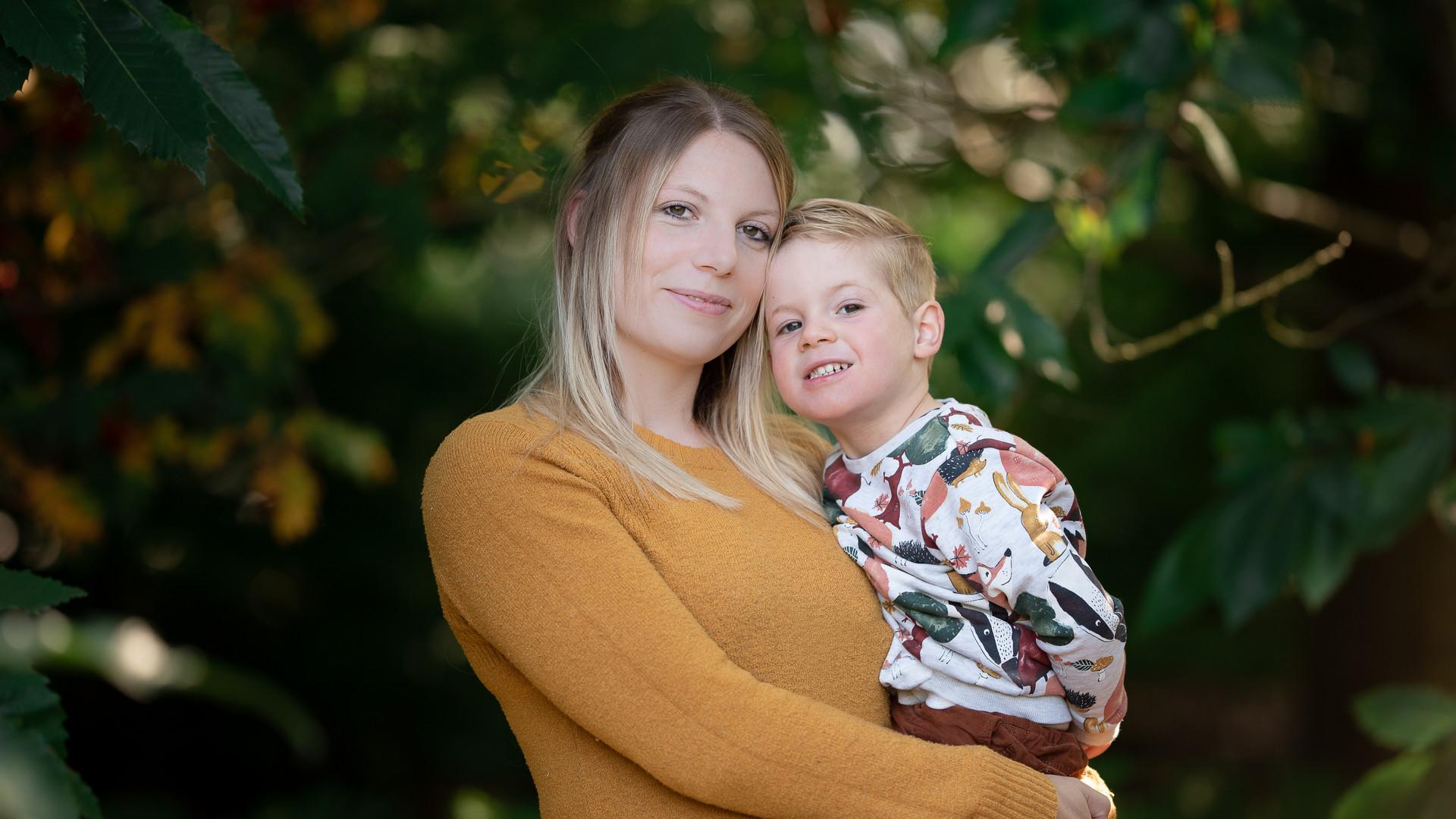 mother holding child.jpg
