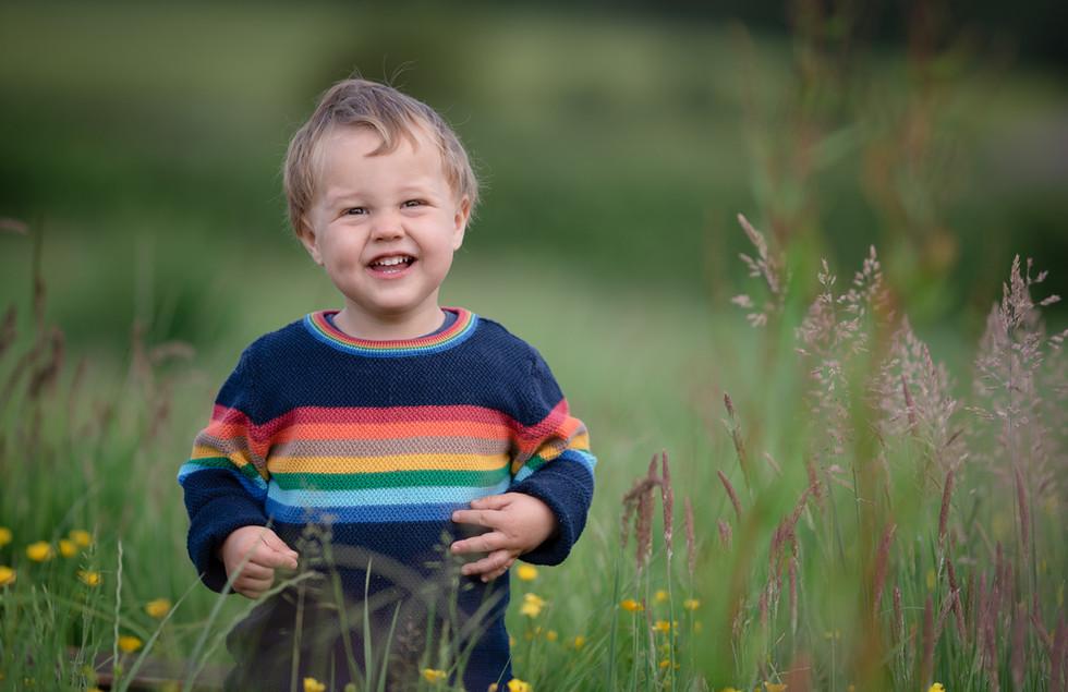 Boy in field, by Somerset nursery photographer Sarah Gibson.jpg