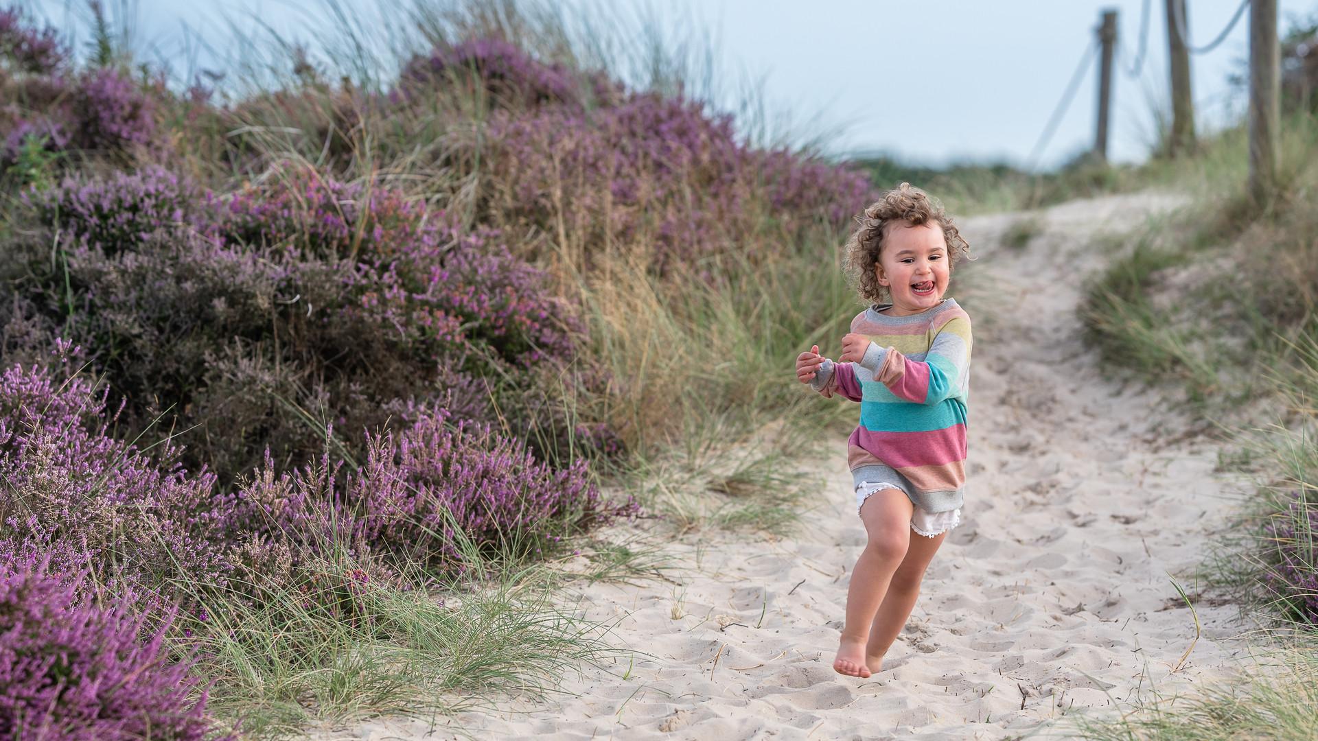 girl running in sand dunes.jpg