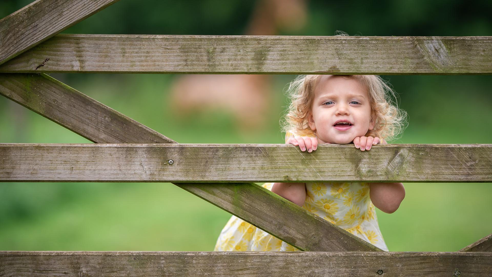 girl peeping through gate.jpg
