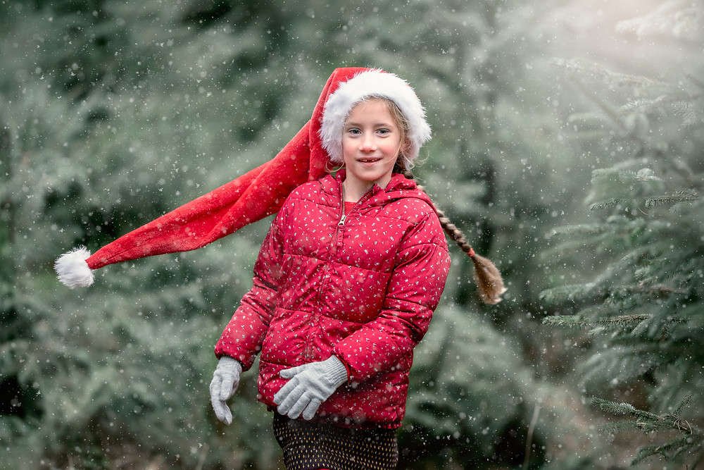 Girl in snow. Photograph captured in Somerset forest, by faily photographer Sarah Gibson