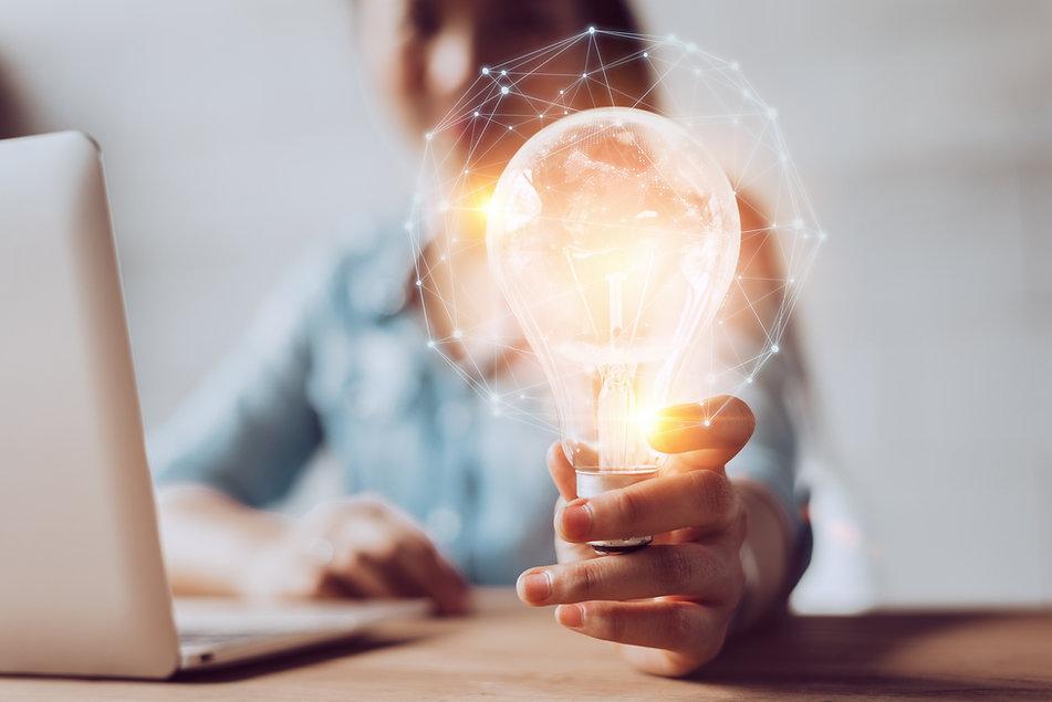Woman with light bulb.jpg
