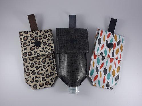 Pochette étui à gel hydroalcoolique amovible  en toile cirée ou coton enduit