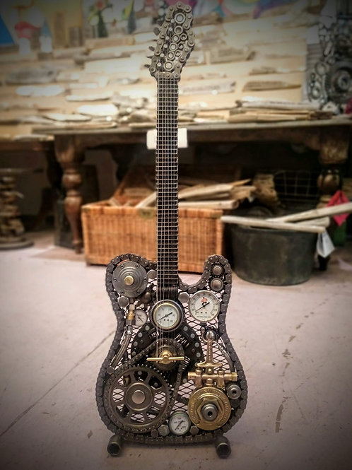 Fender telecaster made from found objects.