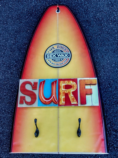 Recycled surfboard for hanging your clothes and hats.