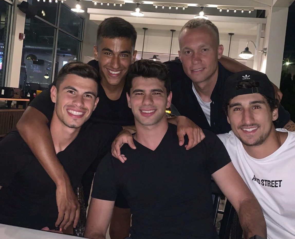 Coaches Giuliano, Enzo, and Joey out to dinner with NYCFC Players