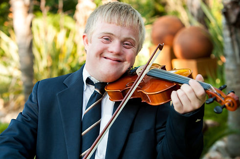 a man with a visable disability playing the violin