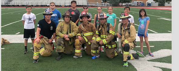 Firefighters of Huron visit students.