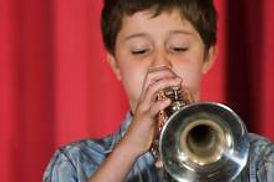 Huron City School Student playing instrument in band.