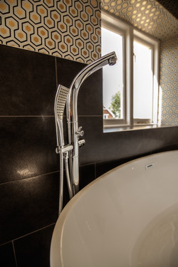 Modern, angular free standing taps