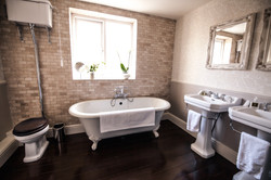 Dark wood and white bathroom