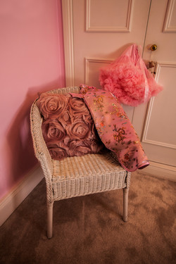 Chair with dressing up clothes