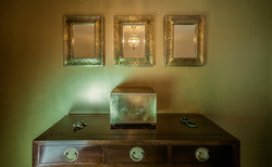 Metallic green wall and mirrors