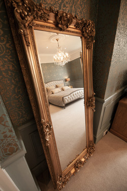 Master bed reflected in a mirror