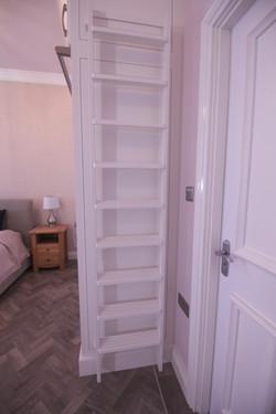 Wardrobe ladders neatly stacked
