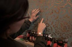Admiring the Nina Campbell wallpaper