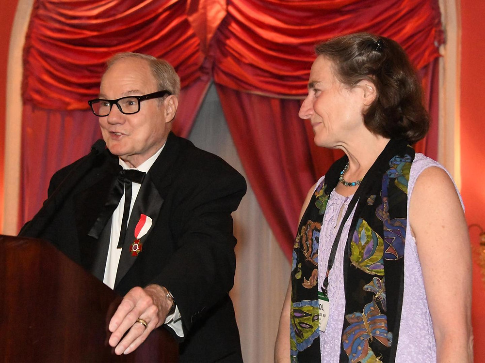 Pictured. Dr. Jerry Shields, with wife Dr. Carol Shields, receives the 2019 Lucien Howe Medal presented by AOS.