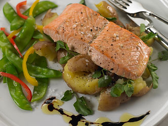 Roasted salmon with crushed potatoes, olive oil, and watercress