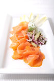 Smoked salmon platter with red onion, lemon, dill and capers