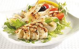 Grilled squid, vidalia onion, and tomato salad