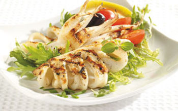 Grilled squid, vidalia onion, and tomato salad