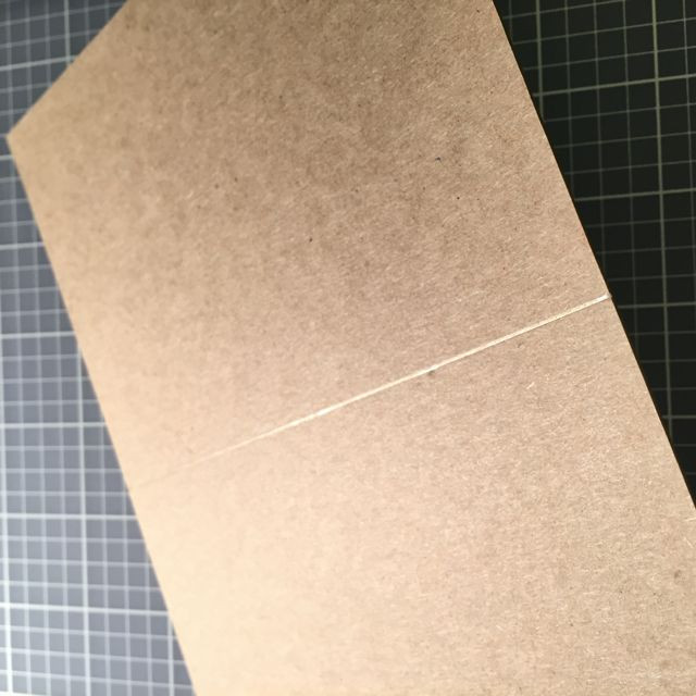 The line is made by pressing down into the card.