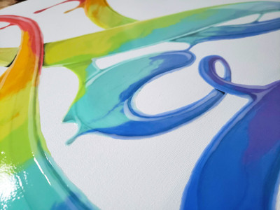 Close up of details on Power of Love 2.0 painting by Shane Turner. Graffiti of the word love made of dripping rainbow paint on calligraphy cursive lettering. Love Pride 2019