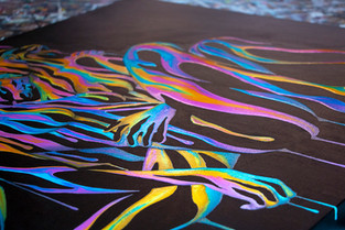 Close up of Right Here in My Arms 3.0 by Shane Turner Art. Painting of LGBTQ lesbian couple hugging each other. Colorful acrylic paint on black canvas.