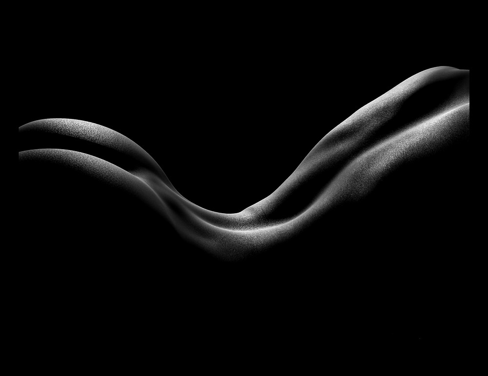 Out of the Shadows 8.0 by Shane Turner. Pointillism dot drawing of artistic nude bodyscape. Laying female figure in black and white created out of dimensional light and negative space. Female figure in white ink on black paper.