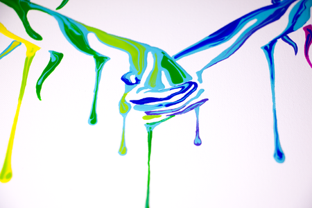 Closeup of Making Love by Shane Turner. Two colorful dripping hands holding onto one another.