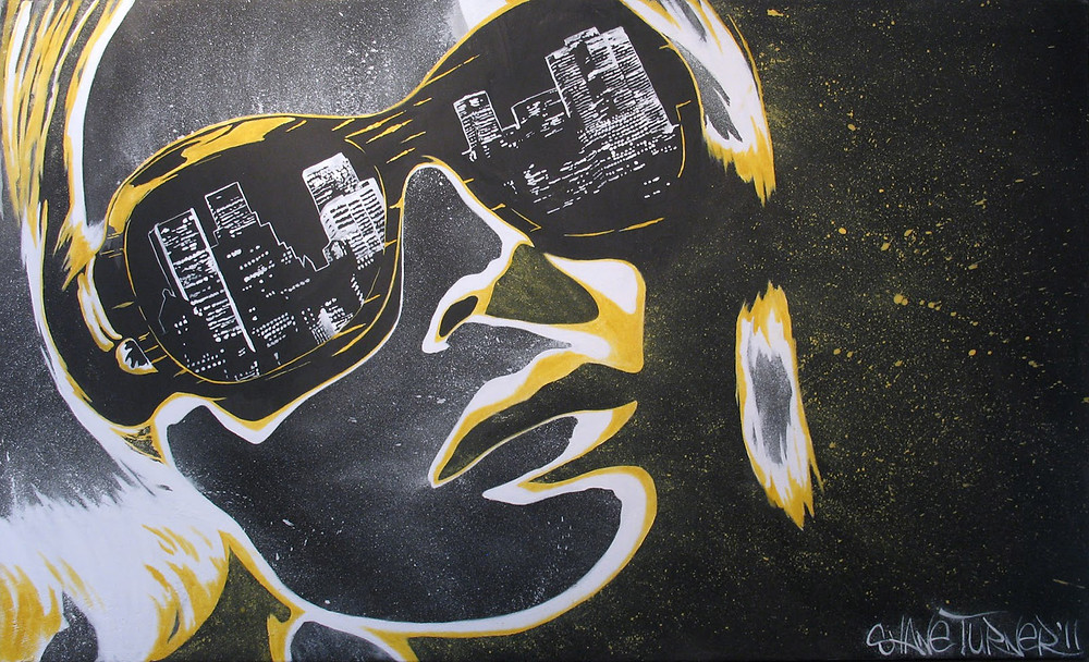 While the City Sleeps by Shane Turner. Acrylic painting on canvas of woman wearing sunglasses with reflection of city in lenses. Yellow and white pop art with graffiti street art edge on a black background.