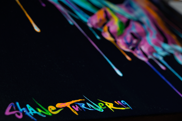 Close up of painted signature on corner of 'Take My Hand' Painting. Shane Turner.
