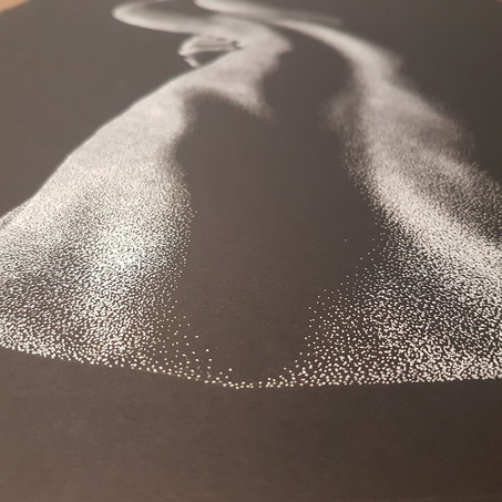 Close up of pointillism stippling details on Out of the Shadows 4.0 by Shane Turner Art. White Ink on black paper.