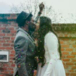 man-in-hat-kissing-woman-in-white-dress-2774081_edited.jpg