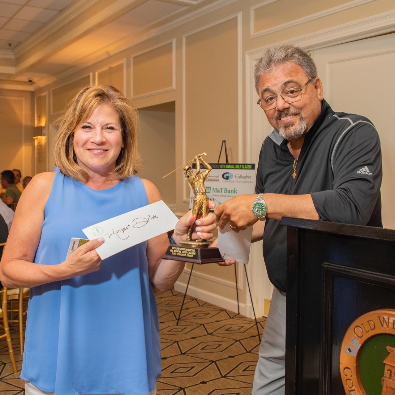 Tina Nocera, Ladies Longest Drive winner and John Tsampas • Photo: Evan Angelastro