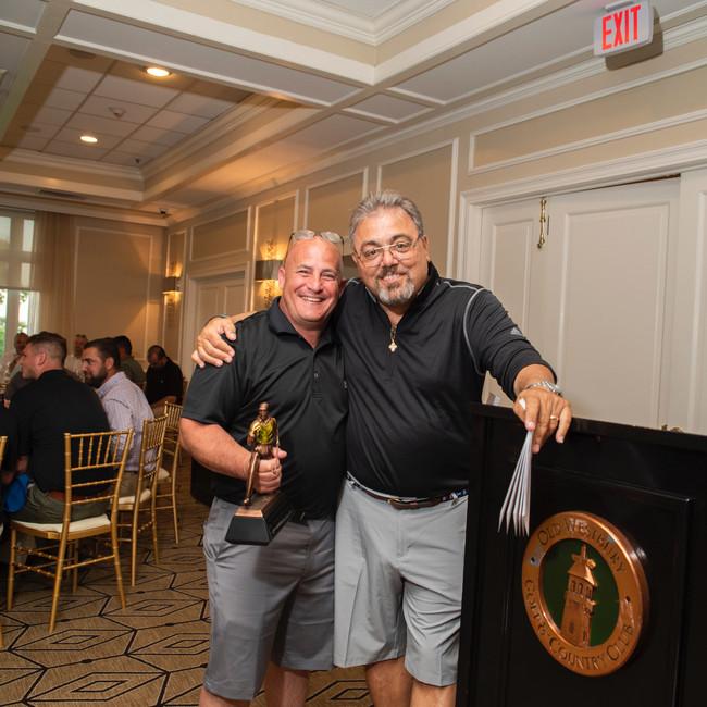 Johnny T. Bone (L), Closest to the Pin winner (Woods), and John Tsampas • Photo: Evan Angelastro