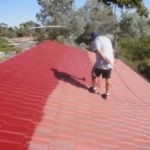 Cost of a roof restoration - tradie spraying
