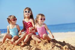 Happy-kids-on-beach-81599488