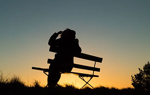silhouette-person-sitting-bench-sunset_1